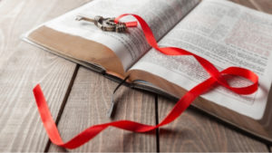 hymn book with key and red ribbon