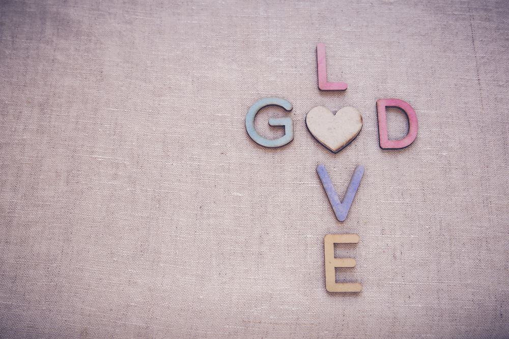 Love God wooden words, toning copy space background