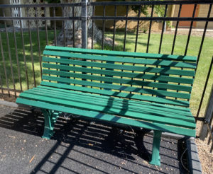 An image of the new green bench in the Heart of Longmont playground, courtesy of the 150th Celebration committee.