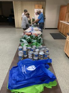 Volunteers put together meal bags for HOL's Chef Hearty program late September.